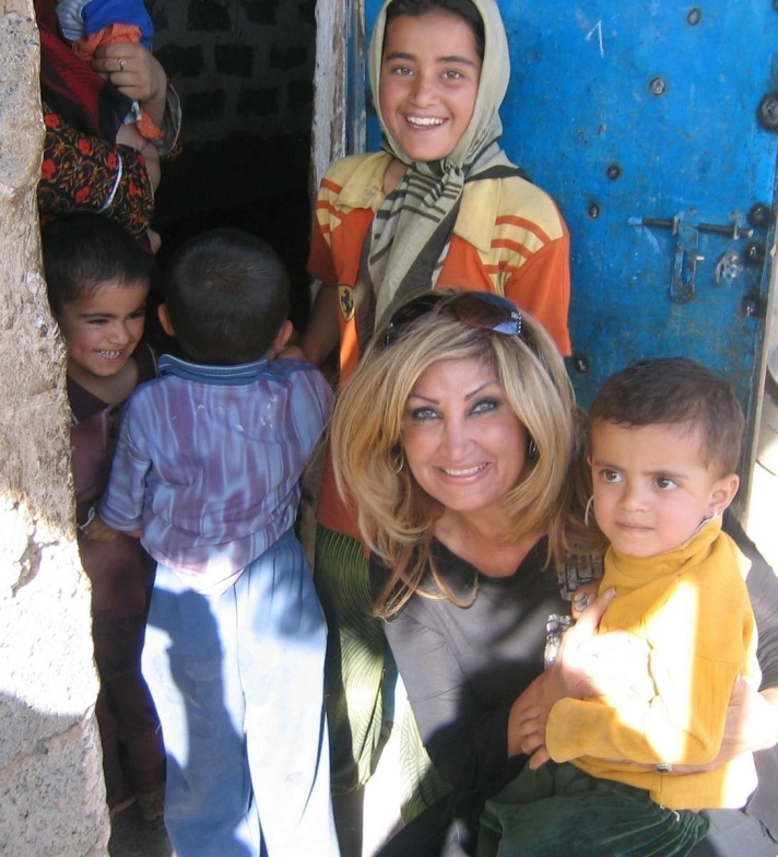 Nidhal with kids she's helped in the Middle East